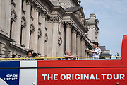 A London tour guide speaks to tourists on the open top deck of an 'Original Tour' bus as it passes government buildings on Whitehall in Westminster, during the Coronavirus pandemic when the tourism industry has hit hard the UK economy and associated jobs, on 16th September 2020, in London, England.