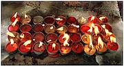 Candles at the feet of Buddha - Bodh Gaya