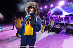 Photographer Polina Krasnova dancing (in 6 degree F/ -14.5 C weather) with friends on Lake Baikal at the wrap party after the close of the Baikal Mile Ice Speed Festival. Maksimiha, Siberia, Russia. Saturday, February 29, 2020. Photography ©2020 Michael Lichter.