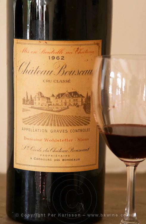A bottle magnum of Chateau Bouscaut 1962 and a glass of 2003 Chateau Bouscaut Cru Classe Cadaujac Graves Pessac Leognan Bordeaux Gironde Aquitaine France
