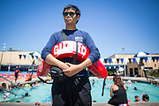 Second year lifeguard Dhe Yon Lee, 18, of Milpitas, watches over swimmers during the Waving the Red, White & Blue Pool Party at the Milpitas Sports Center in Milpitas, California, on July 4, 2014. (Stan Olszewski/SOSKIphoto)