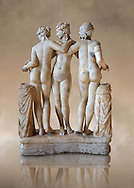 The Three Graces ( Les Trois Grâces ) A 1.19 metres high 2nd century Imperial Roman copy of a circa 330 BC Hellanistic Greek statue.  Found in the Villa Cornovaglia in Rome. Louvre Museum, Paris. Catalogue Number:Louvre Ma 287.<br /> The Three Graces are three nude females that in classic Hellanistic art they are depicted with two facing forward and the middle one facing away. The Three Graces, or Three Charities, of Greek mythology were Aglaia, Euphrosyne, and Thalia. They were the goddesses who symbolised joy, pleasure, grace, beauty, festivity, adornment, dance, and song. Daughters of Zeus and the sea-nymph Eurynome, they were also the attendants, or handmaidens, of Aphrodite and Hera and protectors of vegetation.
