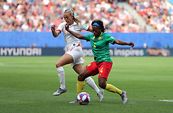 England's Toni Duggan (left) and Cameroon's Yvonne Leuko battle for the ball during the FIFA Women's World Cup, round of Sixteen match at State du Hainaut, Valenciennes.