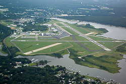 Groton-New London Airport Aerial View. View Northeast. Runway 33 right to left, Runway 5, bottom right, up left.