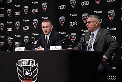 English international soccer player Wayne Rooney speaks as Dave Kasper , United General Manager and VP of Soccer Operations looks on during the media unveiling at the Newseum in Washington, DC.