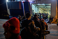 MYTILINI, GREECE - FEBRUARY 09: Refugees queue to enter one of the ferries travelling from Lesvos to the Pireaus port on February 09, 2015 in Mytilini, Greece. Thousands of refugees board everyday ferries from the Greek Islands to the Pireaus port as their first stage of the inland trip in Europe to the dreamed destination. Travel agencies are increasing prices at the Lesvos port as the demand of tickets due to the massive arrivals of refugees had increase considerably. Photo: © Omar Havana. All Rights Are Reserved