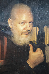 April 11, 2019 - London, England, United Kingdom - Wikileaks founder JULIAN ASSANGE arrives at Westminster Magistrates Court in a police escort to appear where he faces an extradition warrant. (Credit Image: © Rob Pinney/London News Pictures via ZUMA Wire)