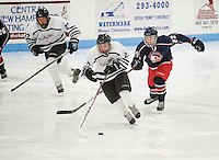 Varsity hockey Laconia-Winnisquam versus  Moultonboro-Interlakes at the Laconia Ice Arena.  Karen Bobotas/for the Laconia Daily Sun