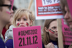 © licensed to London News Pictures. London, UK 21/11/2012. Students and members of the NUS (National Union of Students) march through central London to protest against government cuts to further and higher education, on November 21, 2012. Photo credit: Tolga Akmen/LNP