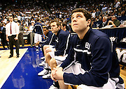 BYU guard Jimmer Fredette, right, looks up at the score board before the start of an NCAA college basketball game against Utah in Provo, Utah, Saturday, Feb. 12, 2011. Also looking on is guard Jackson Emery, left.(AP Photo/Colin E Braley)