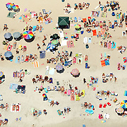 Groups of sunbathers pack Wrightsville Beach, NC, on the Fourth of July, 2007. While crowd control was not a problem, clean-up sweeps showed that more trash than expected was generated.