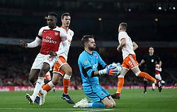 Arsenal's Danny Welbeck has a shot saved by Blackpool goalkeeper Mark Howard