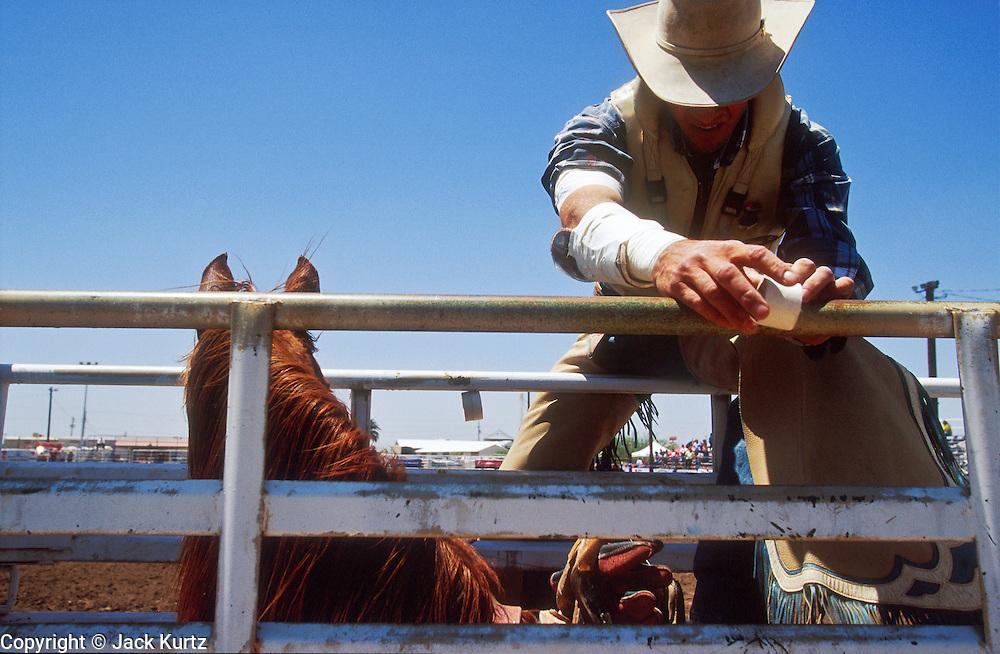 11 MAY 2002 - BUCKEYE, ARIZONA, USA: Paul Brashears, prpeares to ride in the bareback competition at the Arizona West PRCA Rodeo in Buckeye, AZ, May 11, 2002. It was the first year for the Arizona West PRCA Rodeo..PHOTO BY JACK KURTZ