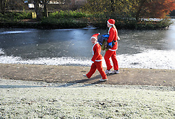 © under license to London News Pictures. 28/11/2010.  Santa's get ready to in the wintery weather to take part in a Santa run in aid of a local cancer hospice today (Sun) Chesham, Buckinghamshire. Photo credit should read: Stephen Simpson/LNP