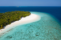 Aerial view of the shore of a beach on a small island in North Province, Maldives