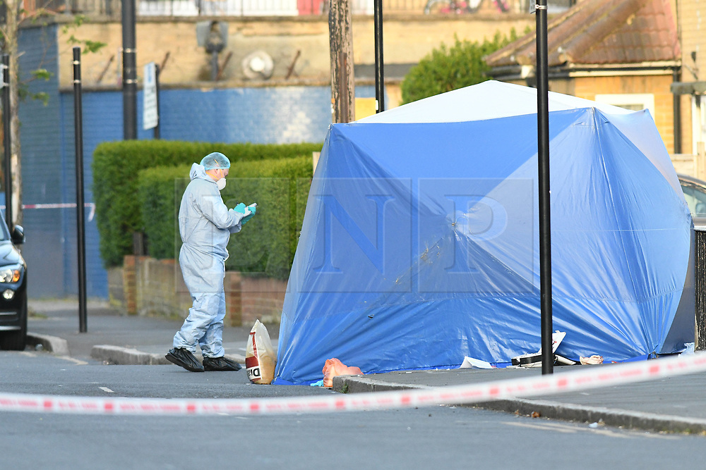©Licensed to London News Pictures; 26/04/2021, London UK; Met police launch another murder investigation in Newham, East London after a male aged 18 was stabbed to death in Coolfin road, Canning Town. Emergency services were called at around 14.45 this afternoon but the victim was pronounced dead at the scene : Photo credit, Steve Poston/LNP