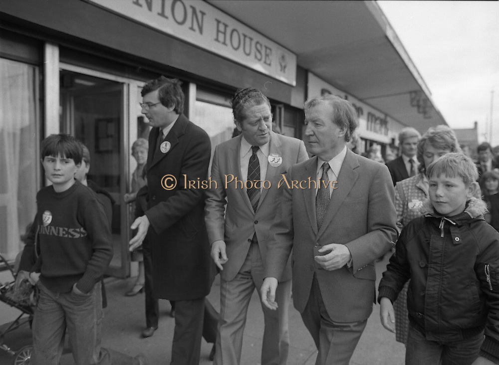 Taoiseach's Election Campaign.      (N77)..1981..23.05.1981..05.23.1981..23rd May 1981..On the 21st May the Taoiseach, Mr Charles Haughey, dissolved the Dáil and called a general election. Charles Haughey, Garret Fitzgerald and Frank Cluskey were leading their respective parties into a general election for the first time as they had only taken party leadership during the last Dáil..Fianna Fáil had hoped to call the election earlier, but the Stardust Tragedy caused the decision to be deferred...Image shows Charles Haughey TD and party colleague Brian Lenihan TD canvassing in Ballyfermot.