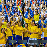Supporters of Nanyang Girls' High cheer during the final of the National 'C' Division Basketball Championship at the OCBC Arena at the Singapore Sports Hub on August 28, 2014, in Singapore.
