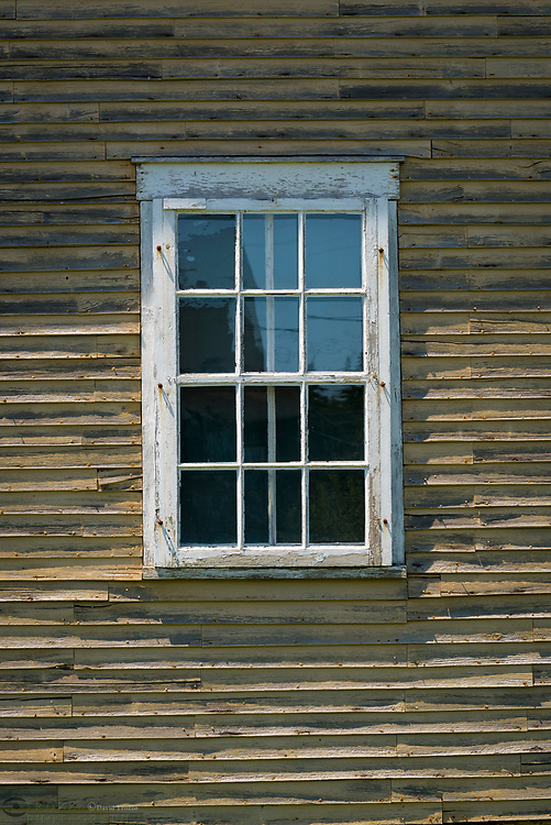 Window on weathered building, Port Clyde. Maine