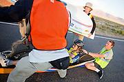 Ellen van Vugt na de avondrun op de derde dag van de races. In Battle Mountain (Nevada) wordt ieder jaar de World Human Powered Speed Challenge gehouden. Tijdens deze wedstrijd wordt geprobeerd zo hard mogelijk te fietsen op pure menskracht. Het huidige record staat sinds 2015 op naam van de Canadees Todd Reichert die 139,45 km/h reed. De deelnemers bestaan zowel uit teams van universiteiten als uit hobbyisten. Met de gestroomlijnde fietsen willen ze laten zien wat mogelijk is met menskracht. De speciale ligfietsen kunnen gezien worden als de Formule 1 van het fietsen. De kennis die wordt opgedaan wordt ook gebruikt om duurzaam vervoer verder te ontwikkelen.<br /> <br /> In Battle Mountain (Nevada) each year the World Human Powered Speed Challenge is held. During this race they try to ride on pure manpower as hard as possible. Since 2015 the Canadian Todd Reichert is record holder with a speed of 136,45 km/h. The participants consist of both teams from universities and from hobbyists. With the sleek bikes they want to show what is possible with human power. The special recumbent bicycles can be seen as the Formula 1 of the bicycle. The knowledge gained is also used to develop sustainable transport.