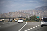 highway ramp with mountains and wind electric energy mills California