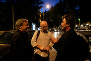 """French musicians Michel Portal, Sebastian Boisseau and Louis Sclavis chat on the street after their concert with swiss drumer Daniel Humair held at Coimbra Jazz festival """"Jazz ao Centro""""."""