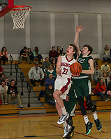 Derek Stevens of Belmont goes for the basket pressured by Joseph Minson of Monadnock during NHIAA Division III Basketball Friday evening.  (Karen Bobotas/for the Laconia Daily Sun)
