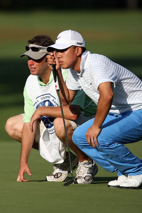 09 August 2007: Anthony Kim and caddie Ron Levin analyze the 3rd green during the first round of the 89th PGA Championship at Southern Hills Country Club in Tulsa, OK.