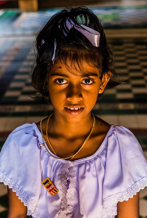 School girl, Isurumuniya Temple, Anuadhapura. SrI Lanka. Anuradhapura is one of the ancient capitals of Sri Lanka, famous for its well-preserved ruins of an ancient Sri Lankan civilization.