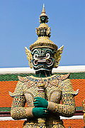 Demon Giant statue guards an entrance to The Grand Palace, Bangkok, Thailand