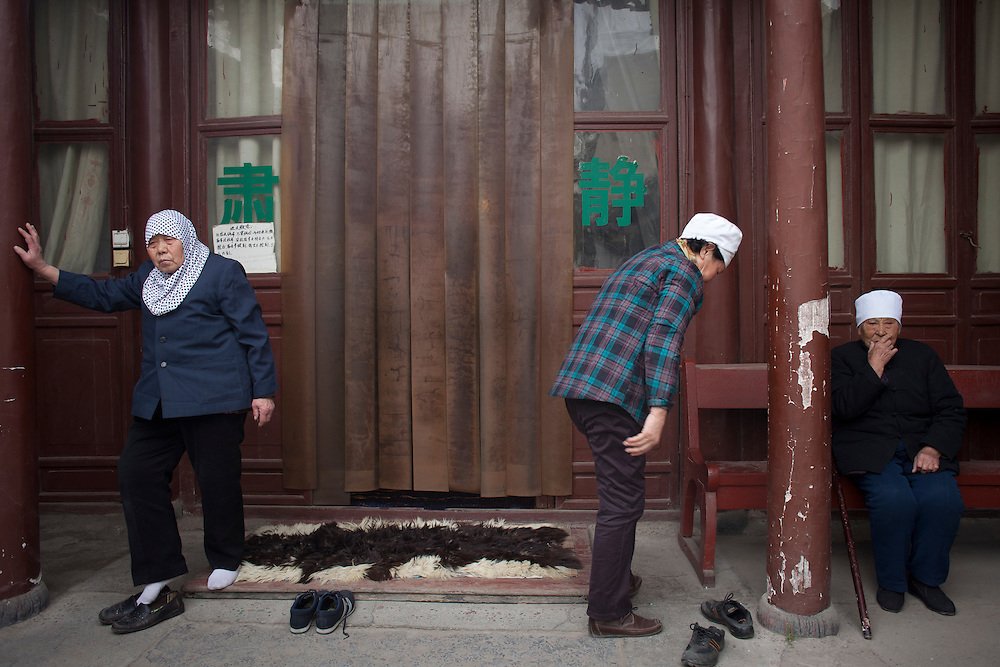 Women leave the at the Wangjia Hutong Women's Mosque after prayers in Kaifeng, China.