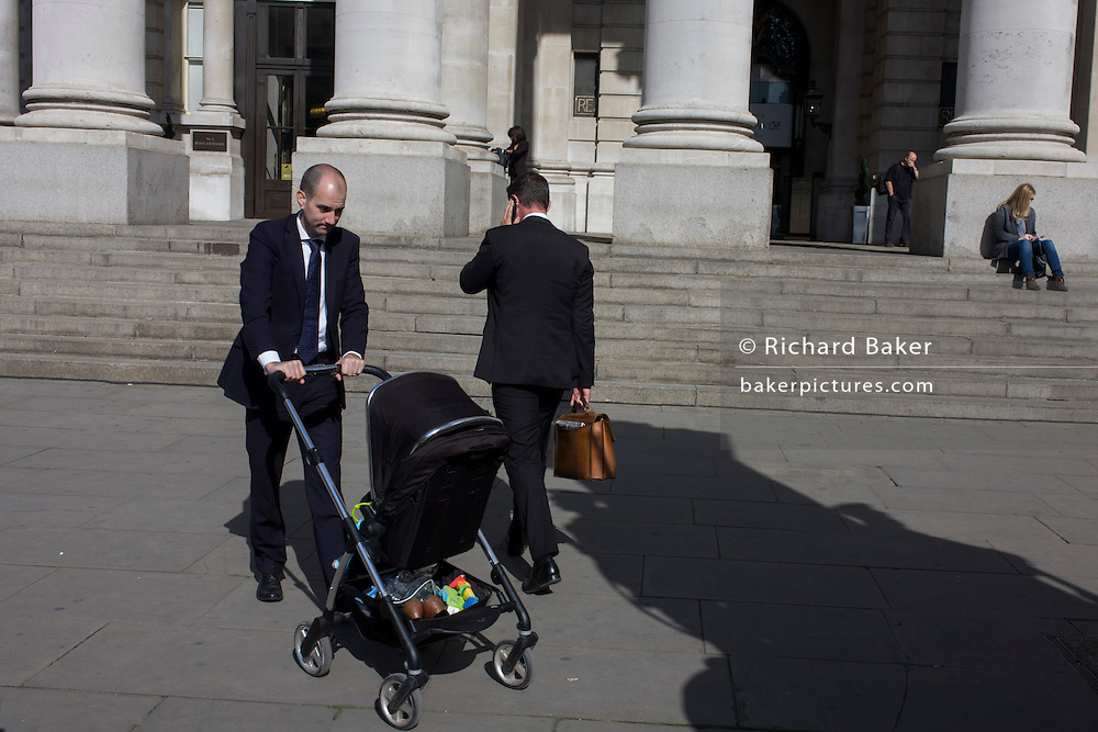 A businessman childminds in the City of London.