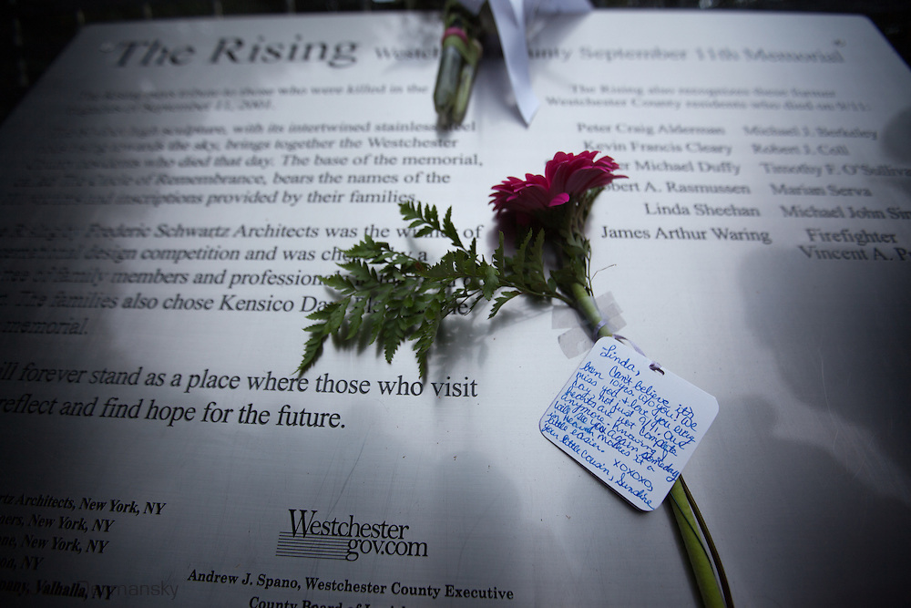 A note to a victim of 9/11 left on a plaque at the Rising, a memorial located in the Kensico Dam Plaza of Valhalla, Westchester County, New York, created by architect Frederic Schwartz commemorating the victims of 9/11 from Westchester County   on the 10 Year Anniversary of 9/11