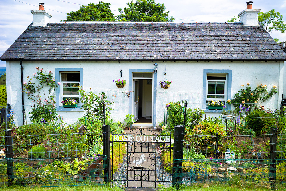 Quaint traditional bungalow cottage with neat front garden at Salen, Isle of Mull in the Inner Hebrides and Western Isles, West Coast of Scotland