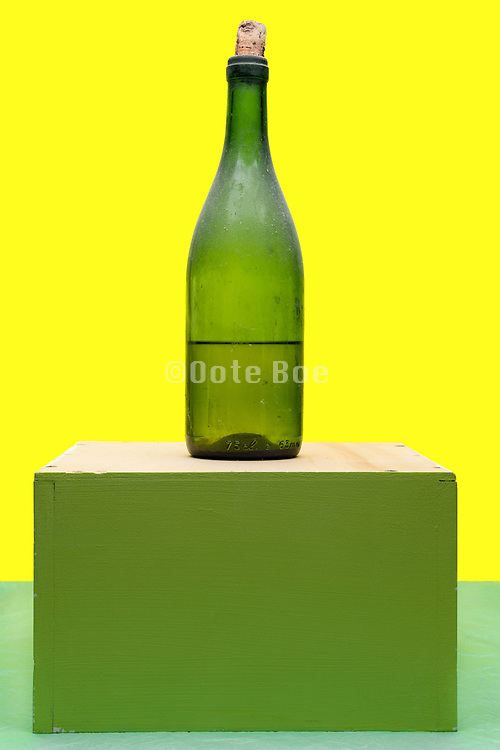 old dusty wine bottle with a half full liquid content