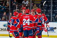 KELOWNA, CANADA - MARCH 13:  Ty Smith #24 of the Spokane Chiefs congratulates his line on a goal against the Kelowna Rockets on March 13, 2019 at Prospera Place in Kelowna, British Columbia, Canada.  (Photo by Marissa Baecker/Shoot the Breeze)