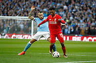 Nicolas Otamendi of Manchester City (l) looks to tackle Daniel Sturridge of Liverpool. Capital One Cup Final, Liverpool v Manchester City at Wembley stadium in London, England on Sunday 28th Feb 2016. pic by Chris Stading, Andrew Orchard sports photography.