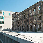 MOSTAR, BOSNIA AND HERZEGOVINA - JUNE 28:  A newly refurbished building is seen next to a derelict hotel from the time of 1993 war on June 28, 2013 in Mostar, Bosnia and Herzegovina. The Siege of Mostar reached its peak and more cruent time during 1993. Initially, it involved the Croatian Defence Council (HVO) and the 4th Corps of the ARBiH fighting against the Yugoslav People's Army (JNA) later Croats and Muslim Bosnian began to fight amongst each other, it ended with Bosnia and Herzegovina declaring independence from Yugoslavia.  (Photo by Marco Secchi/Getty Images)