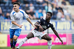 Queen of the South's Ian McShane and Falkirk's Botti Biabi.<br /> Falkirk 1 v 1 Queen of the South, Scottish Championship game played today at The Falkirk Stadium.