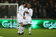Renato Sanches of Swansea city ® speaks to Angel Rangel of Swansea city (l) as Angel leaves the field with an injury. Premier league match, Swansea city v Tottenham Hotspur at the Liberty Stadium in Swansea, South Wales on Tuesday 2nd January 2018. <br /> pic by  Andrew Orchard, Andrew Orchard sports photography.