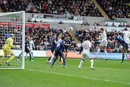 Swansea city's Michu (9) scores his sides goal with a header to make it 2-1 to Spurs. Barclays Premier League, Swansea city v Tottenham Hotspur at the Liberty Stadium in Swansea, South Wales on Saturday 30th March 2013. pic by Andrew Orchard, Andrew Orchard sports photography,