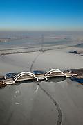 Nederland, Noord-Holland, Amsterdam, 10-01-2009; IJburg: Enneus Heermabrug naar stadsdeel IJburg, Buiten-IJ gezien naar Durgerdam; ijsveld met spoor van schip wat (nog) door het ijs gevaren is;.ice-field in the northeast part of Amsterdam, trace oh ship sailing trough ice; ijsschots, ijsveld, veld, schots, schotsen, ijsgang, ijs, natuurijs, winter, koud, vriezen, min nul, beneden nul, koud, celsius, ice, snow, cold, freezing, minus zero, below zero, cold, winterlandschap, winter landscape. .luchtfoto (toeslag); aerial photo (additional fee required); .foto Siebe Swart / photo Siebe Swart