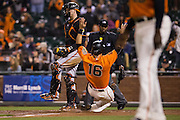 San Francisco Giants left fielder Angel Pagan (16) slides into home for a run in the ninth inning against the Baltimore Orioles at AT&T Park in San Francisco, Calif., on August 12, 2016. (Stan Olszewski/Special to S.F. Examiner)