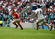 Wales' Hallam Amos looks to evade England's Jack Clifford during the The Old Mutual Wealth Cup match England -V- Wales at Twickenham Stadium, London, Greater London, England on Sunday, May 29, 2016. (Steve Flynn/Image of Sport)
