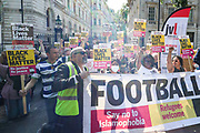 London, United Kingdom, July 17, 2021: Protestors take a knee outside Downing Street during the Stand Up to Racism protest in central London on Saturday, July 17, 2021. The protest is organised in solidarity with England players Marcus Rashford, Jadon Sancho and Bukayo Saka who were subject of racist hate crimes in Britain following the defeat of England in the Euro 2020 finals from Italy. (VX Photo/ Vudi Xhymshiti)