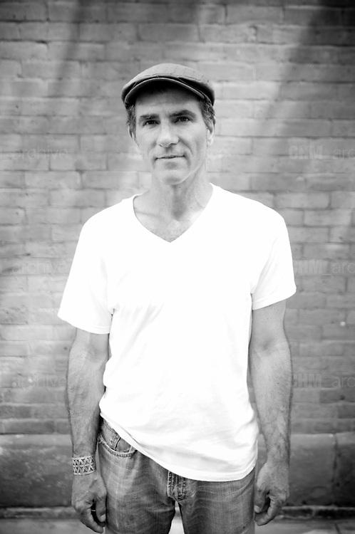 Man in the street,  Lower east side. New York City, 23 june 2010. Christian Mantuano / OneShot