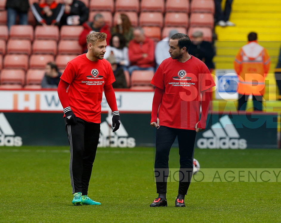 Harry Chapman of Sheffield Utd and Samir Carruthers of Sheffield Utd during the English League One match at Bramall Lane Stadium, Sheffield. Picture date: April 17th 2017. Pic credit should read: Simon Bellis/Sportimage