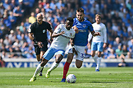 Coventry City Forward, Bright Enobakhare (24) and Portsmouth Midfielder, Ben Close (33) challenge for the ball during the EFL Sky Bet League 1 match between Portsmouth and Coventry City at Fratton Park, Portsmouth, England on 22 April 2019.