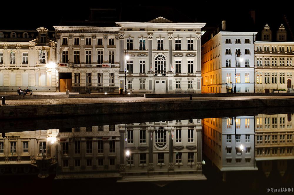 Buildings of Korenlei pier by night, Ghent, Belgium, Europe