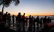 Athletes head into Lake Monona for the start of the Ironman Wisconsin triathlon. (Photo © Andy Manis)